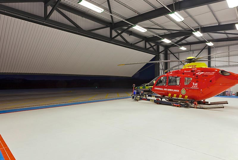 hydroswing aircraft hangar doors air ambulance eurocopter ec 135 bond helicopters