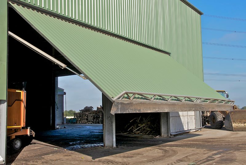 hydroswing europe uk agricultural hydraulic overhead doors biomass industry