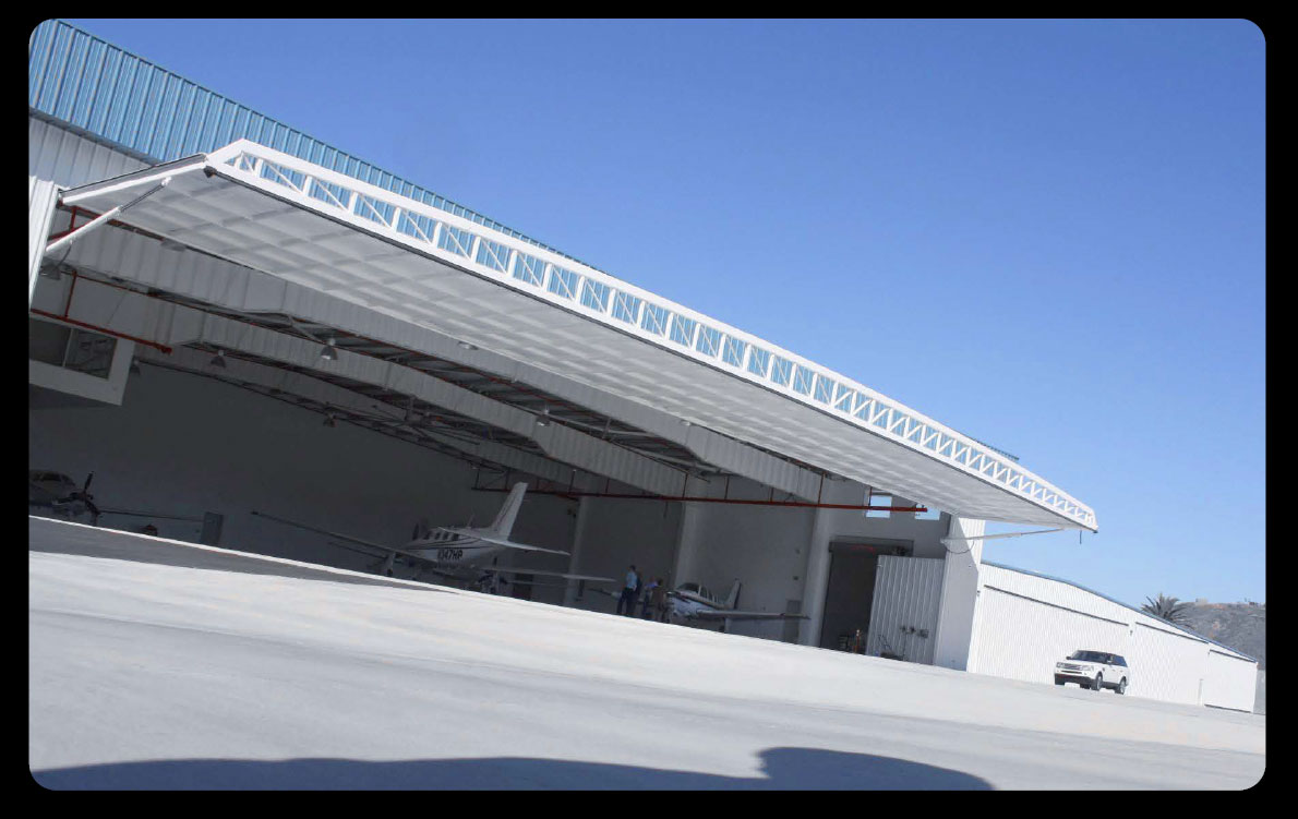 large hydraulic hangar door wide span hydroswing door
